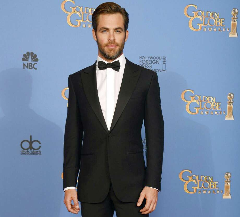 "FILE - In this Sunday, Jan. 12, 2014 file photo, actor Chris Pine poses in the press room at the 71st annual Golden Globe Awards at the Beverly Hilton Hotel, in Beverly Hills, Calif. Pine says the US should have done more in the run-up to the Olympics to protest Russia's anti-gay legislation, which he calls ""clearly awful, archaic, hostile nonsense."" ""I think we should do more than just send gay Olympians there,"" he said in an interview while promoting his film ""Jack Ryan: Shadow Recruit,"" which opens Friday, Jan. 17, 2014.  (Photo by Jordan Strauss/Invision/AP) ORG XMIT: CAET732 Photo: Jordan Strauss / Invision"