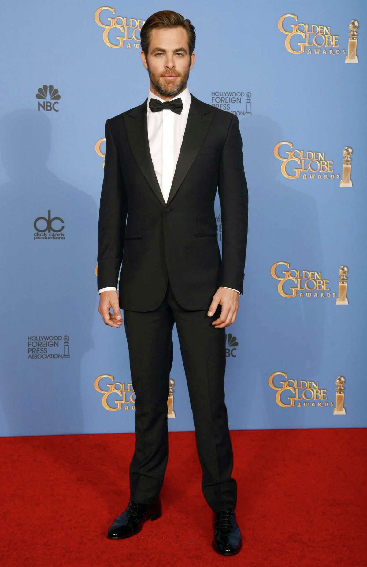 """FILE - In this Sunday, Jan. 12, 2014 file photo, actor Chris Pine poses in the press room at the 71st annual Golden Globe Awards at the Beverly Hilton Hotel, in Beverly Hills, Calif. Pine says the US should have done more in the run-up to the Olympics to protest Russia?'s anti-gay legislation, which he calls ?""""clearly awful, archaic, hostile nonsense.?"""" ?""""I think we should do more than just send gay Olympians there,?"""" he said in an interview while promoting his film ?""""Jack Ryan: Shadow Recruit,"""" which opens Friday, Jan. 17, 2014. (Photo by Jordan Strauss/Invision/AP) ORG XMIT: CAET733"""