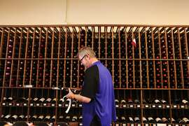 "Mike ""Guido"" Parres, an Italian wine specialist, restocks bottles of wine on October 30, 2013 at K&L Wine Merchants on 4th Street in San Francisco, Calif."