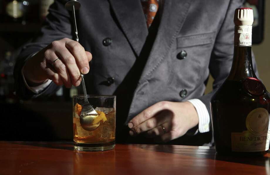 Sampling a variety of liquor, wine and beer or witnessing bartenders competing doesn't have to break the bank. Photo: Helen L. Montoya / San Antonio Express-News / SAN ANTONIO EXPRESS-NEWS