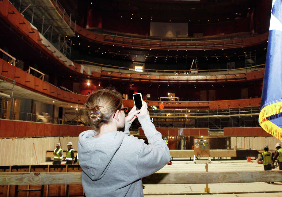 Sofia Prestigiacomo takes a panoramic photo with her phone of the inside of the Tobin Center for the Performing Arts Wednesday, Jan. 15, 2014 as an announcements are made about the Tobin Wall of Memories, where people are being asked to send photos and their memories from events at the Municipal Auditorium and the announcement of a $1,250,000 gift  from the Mays Family Foundation. The Tobin Center is set to open in September 2014. Photo: Cynthia Esparza, For The San Antonio Express-News / For San Antonio Express-News