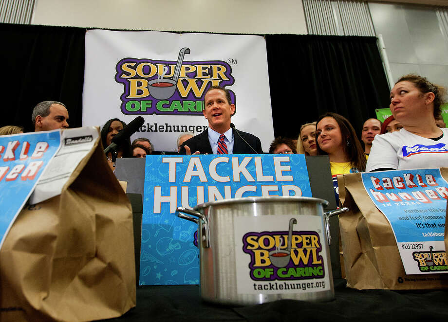 Houston Texans President Jamie Rootes speaks during the kickoff of the Souper Bowl of Caring Houston 2014 campaign at the Houston Food Bank, Wednesday, Jan. 15, 2014, in Houston. Photo: Cody Duty, Houston Chronicle / © 2014 Houston Chronicle
