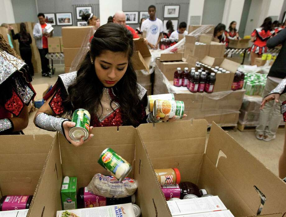 Cypress Lakes High School sophomore volunteer Lesly Granados sorts donated goods at the Houston Food Bank during the kickoff of the Souper Bowl of Caring Houston 2014, Wednesday, Jan. 15, 2014, in Houston. Photo: Cody Duty, Houston Chronicle / © 2014 Houston Chronicle
