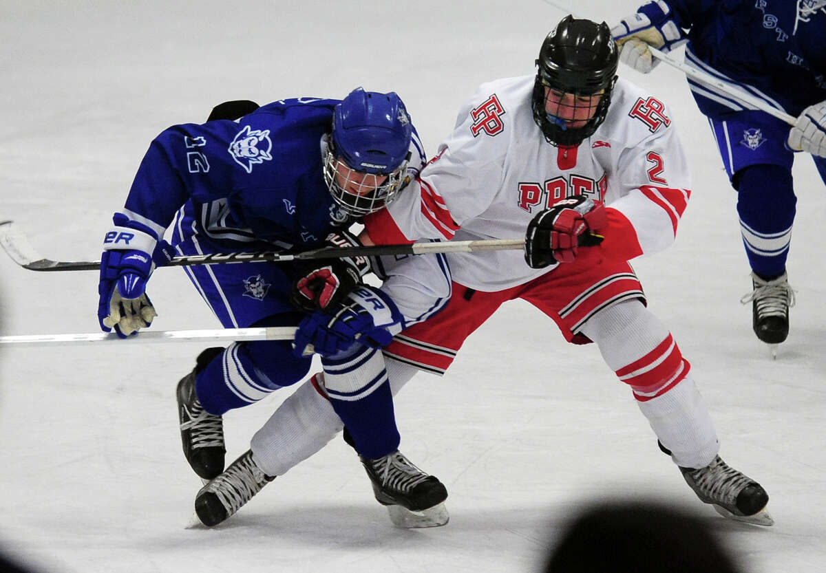 Fairfield Prep's William Burke Smith, right, gets tangled up with West Haven's Joe Ayala, during boys hockey action at the Wonderland of Ice in Bridgeport, Conn. on Thursday January 9, 2014.