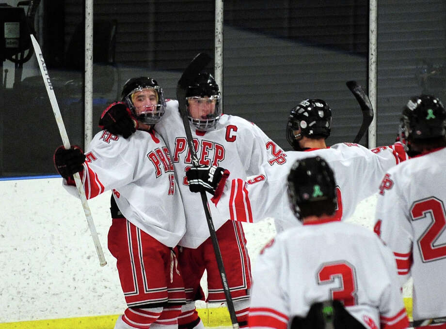 Fairfield Prep celebrates a goal, during boys hockey action against West Haven at the Wonderland of Ice in Bridgeport, Conn. on Thursday January 9, 2014. Photo: Christian Abraham / Connecticut Post