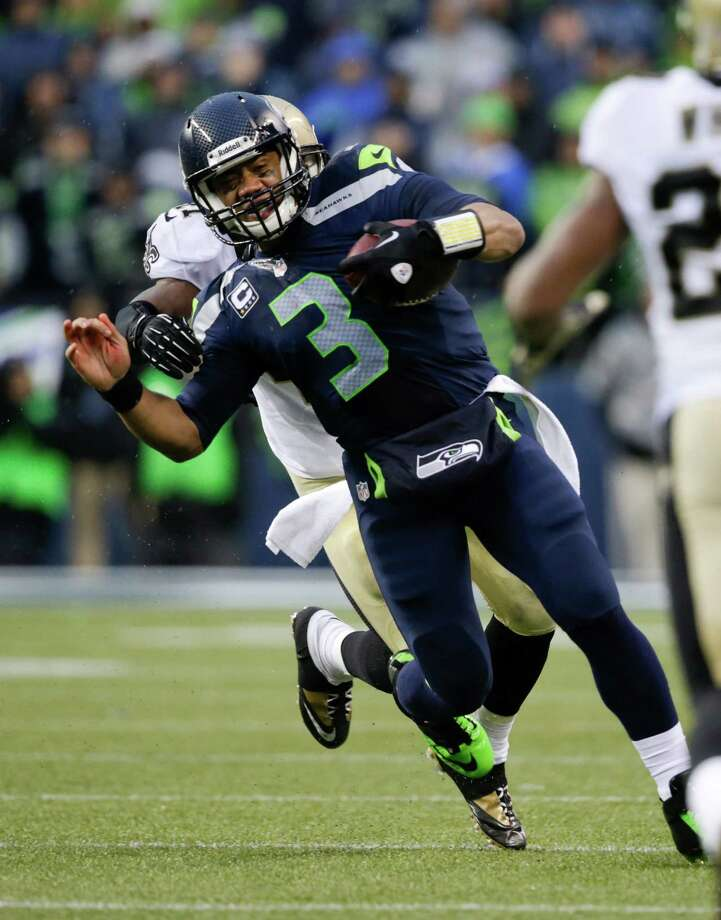 Quarterback Russell Wilson guided a sputtering offense against the Saints, but the Seahawks still won 23-15. Photo: John Froschauer, FRE / FR74207 AP