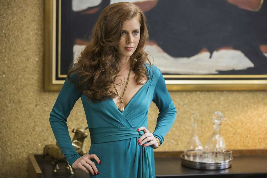 "And now, the best actresses. Amy Adams as Sydney Prosser in ""American Hustle."" She's been nominated five times in the past nine years and has yet to win. It's her first Best Actress nomination.  Photo: Francois Duhamel, Associated Press"