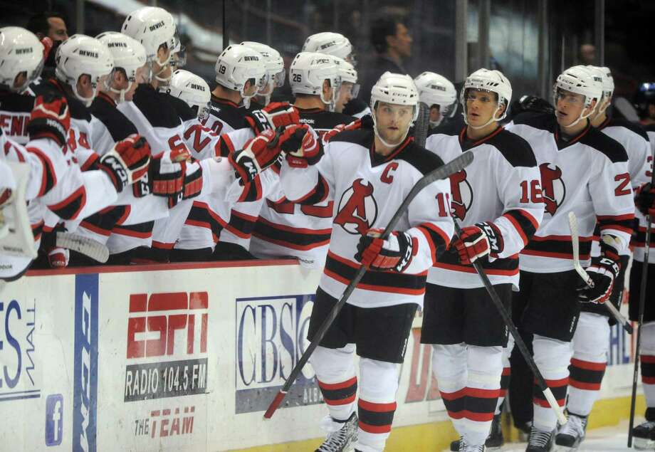 Devil's Rod Pelley, center, gets congratulated by teammates after scoring a goal during their hockey game against Springfield at the Times Union Center on Wednesday Dec. 4, 2013 in Albany, N.Y. (Michael P. Farrell/Times Union) Photo: Michael P. Farrell / 00024917A
