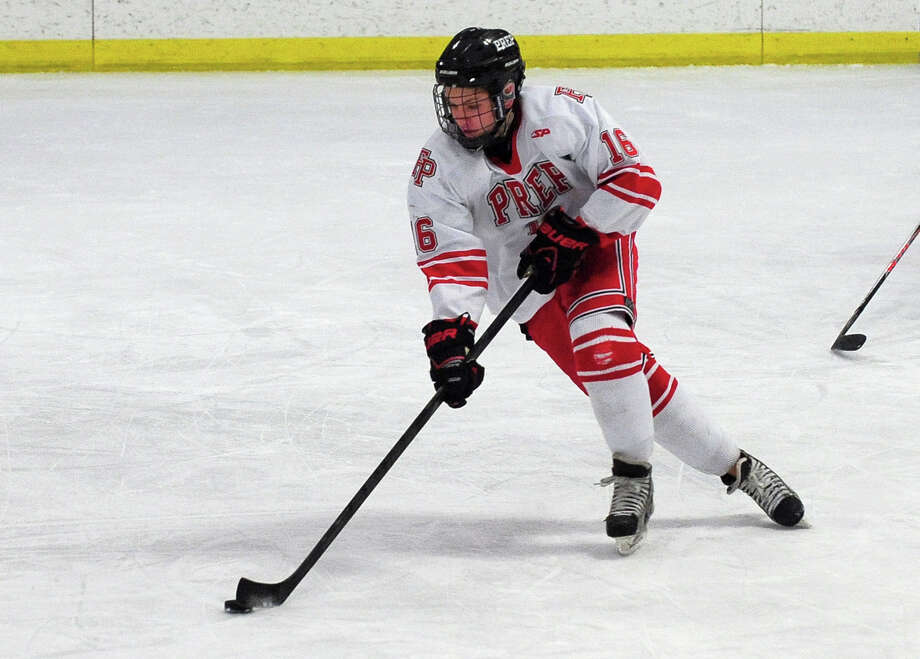 Fairfield Prep's John Hoey moves the puck, during boys hockey action against West Haven at the Wonderland of Ice in Bridgeport, Conn. on Thursday January 9, 2014. Photo: Christian Abraham / Connecticut Post