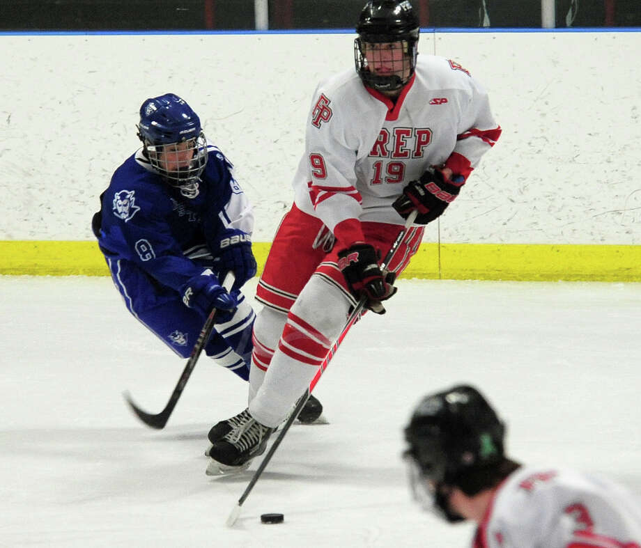 Fairfield Prep's Steven Bales looks to pass the puck, during boys hockey action against West Haven at the Wonderland of Ice in Bridgeport, Conn. on Thursday January 9, 2014. Photo: Christian Abraham / Connecticut Post