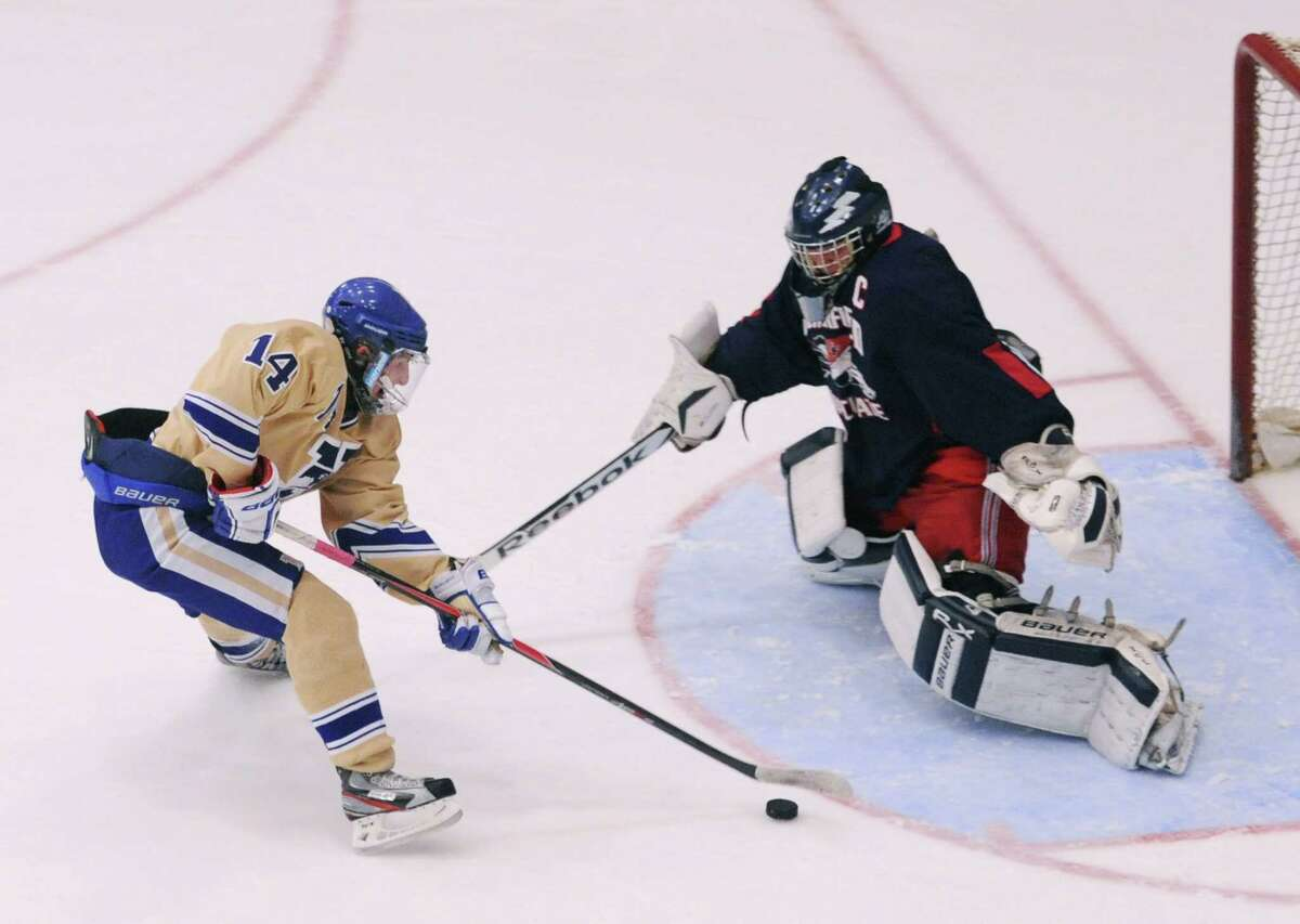 Newtown's Jonathan Lovorn attempts a shot past New Fairfield/Immaculate goalie Ryan Dobos in the high school hockey game between Newtown and New Fairfield/Immaculate at Danbury Arena in Danbury, Conn. on Wednesday, Jan. 15, 2014.