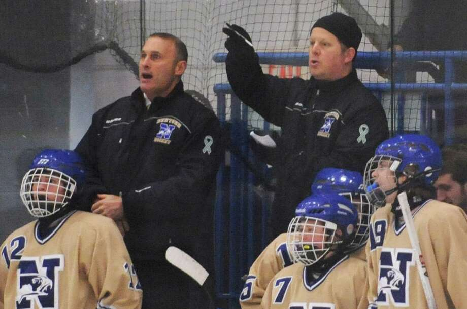 Newtown coach Paul Esposito, right, directs his players in the high school hockey game between Newtown and New Fairfield/Immaculate at Danbury Arena in Danbury, Conn. on Wednesday, Jan. 15, 2014. Photo: Tyler Sizemore / The News-Times