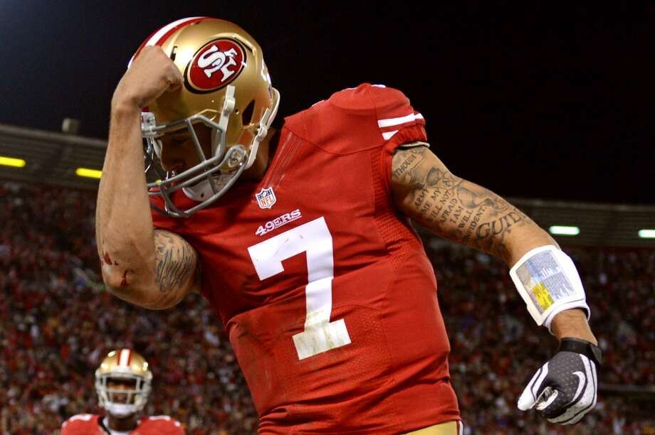 9. Colin Kaepernick  The Niners' quarterback is essentially the complete opposite of Russell Wilson. With more ink than humility, Kaepernick showboats, brags, mocks and comes off as a thug. To top it all off, he's actually pretty good. Photo: Harry How, Getty Images