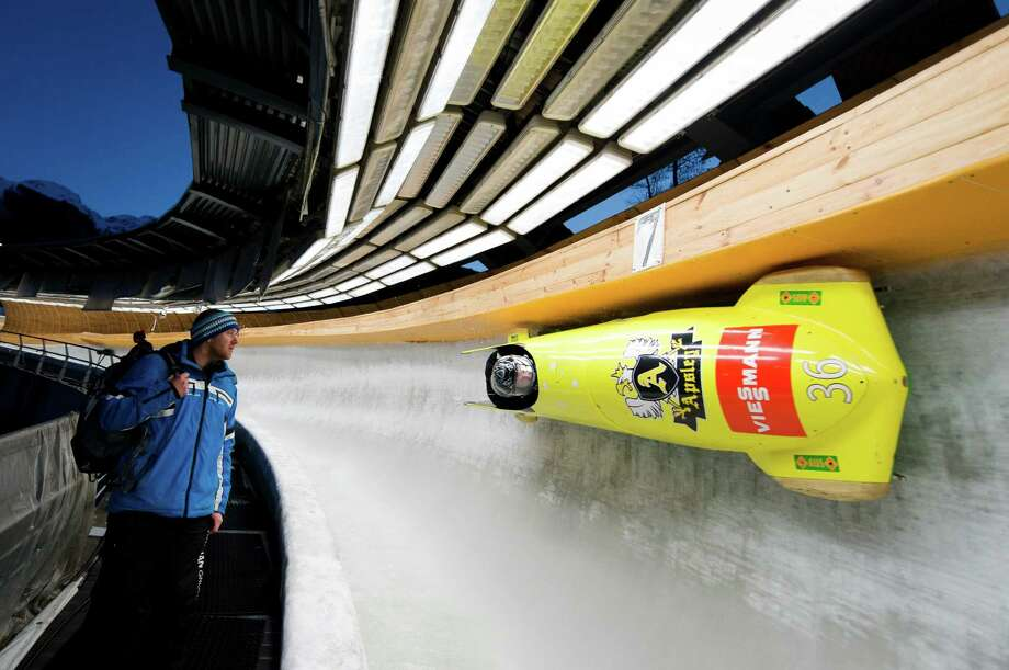 Australia's Heath Spence takes part in a Men's Bobsleigh training run at the Sanki Sliding Centre, one of the 2014 Winter Olympics venues, at Rzhanaya Polyana, 60 km northeast of the Black Sea city of Sochi, on February 14, 2013. With a year to go until the Sochi 2014 Winter Games, construction work continues as tests events and World Championship competitions are underway.  AFP PHOTO / LEON NEAL        (Photo credit should read LEON NEAL/AFP/Getty Images) Photo: LEON NEAL / 2013 AFP