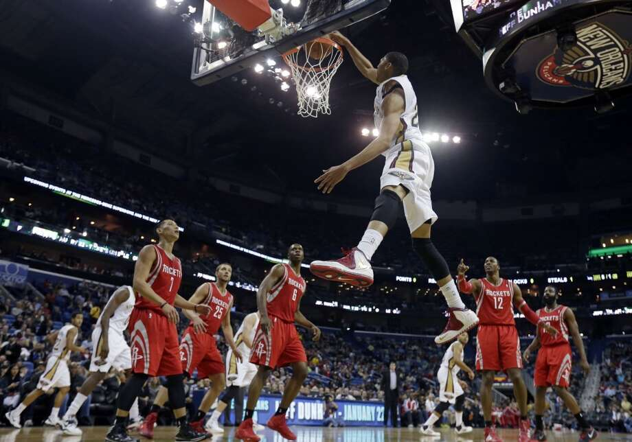 Pelicans power forward Anthony Davis (23) slam dunks. Photo: Gerald Herbert, Associated Press