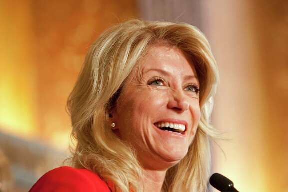 Sen. Wendy Davis who announced that she will be running for governor, speaks during a press conference at City Hall where she, Mayor Annise Parker, City Council Member Ellen Cohen and Harris County Sheriff Adrian Garcia reiterated the fact that there is no longer a backlog of rape kits in Houston Wednesday, Oct. 9, 2013.  Davis wrote a bill that addressed the problems with the backlog of rape kits and process of which rape kits and those affected were handled. Parker pointed out that with the help of Davis, the city was able to obtain federal funding to help pay to eliminate the backlog of more than 6,000 rape kits. One arrest and one conviction came out of the 6,000 rape kits tested. ( Johnny Hanson / Houston Chronicle )