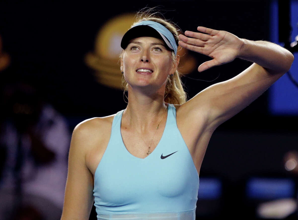 Maria Sharapova of Russia celebrates after winning over Bethanie Mattek-Sands of the U.S. during their first round match at the Australian Open tennis championship in Melbourne, Australia, Tuesday, Jan. 14, 2014.(AP Photo/Aaron Favila) ORG XMIT: XMEL289
