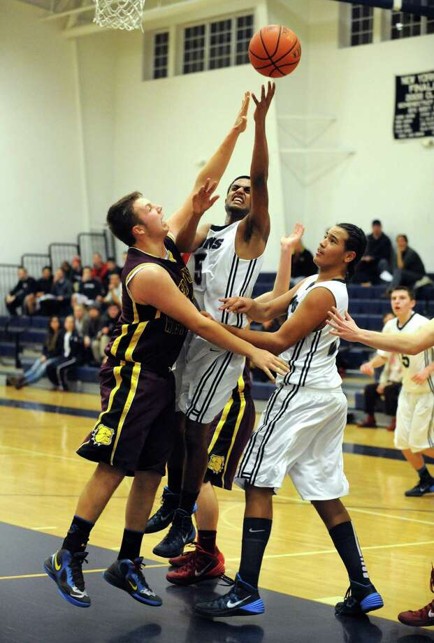 Mekeel Christian Academy's Mano Senthil goes in for a basket during their boy's high school basketball game against Berne-Knox Westerlo on Wednesday  Jan. 15, 2014 in Scotia, N.Y. (Michael P. Farrell/Times Union) Photo: Michael P. Farrell / 00025342A
