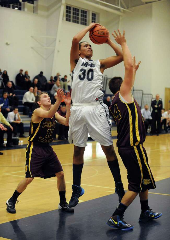 Mekeel Christian Academy's Damonte White goes in for a basket during their boy's high school basketball game against Berne-Knox Westerlo on Wednesday  Jan. 15, 2014 in Scotia, N.Y. (Michael P. Farrell/Times Union) Photo: Michael P. Farrell / 00025342A