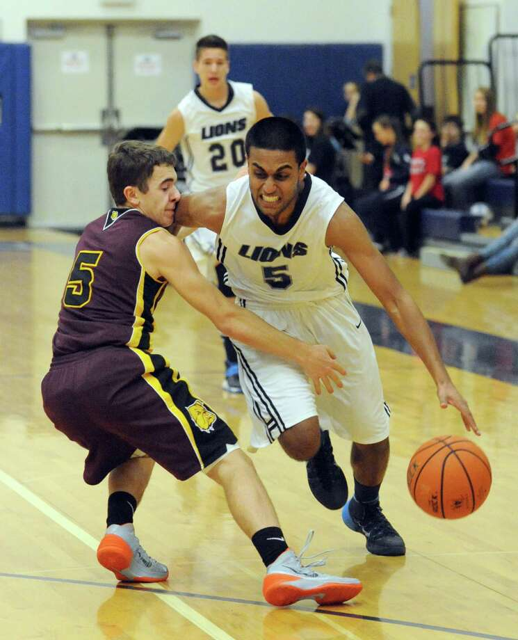Mekeel Christian Academy's Mano Senthil drives to the basket during their boy's high school basketball game against Berne-Knox Westerlo on Wednesday  Jan. 15, 2014 in Scotia, N.Y. (Michael P. Farrell/Times Union) Photo: Michael P. Farrell / 00025342A