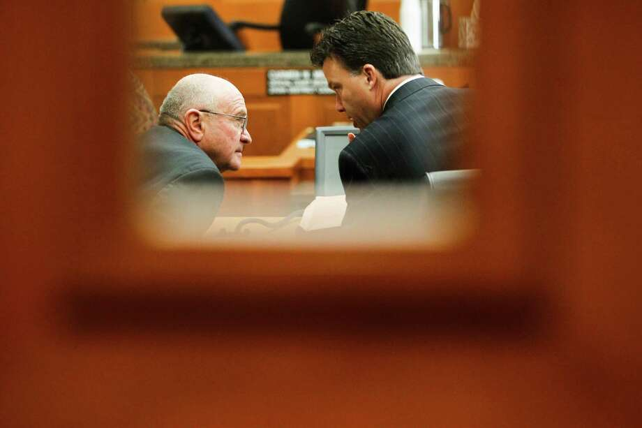 Dave Wilson, left, confers with his attorney during Wednesday's court hearing that ended with a ruling in his favor. Photo: Johnny Hanson/Houston Chronicle