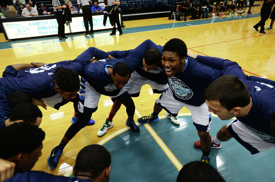 Lamar State College Seahawks Evan White, right, No. 12, chants with his team before Wednesday's game against Houston Community College at Port Arthur College. Michael Rivera/@michaelrivera88   Photo taken Wednesday, 01/15/14