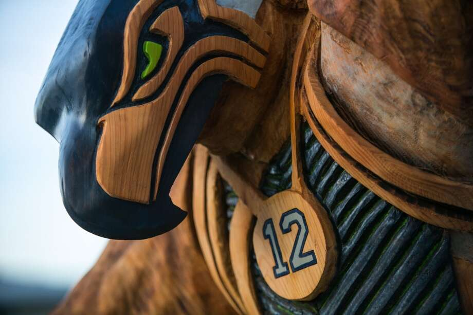 Jacob Lucas' chainsaw art is show on Wednesday, January 15, 2014. The Bonney Lake artist spent more than three weeks creating the tribute to the Seattle Seahawks, the 12th Man and Native American culture. (Joshua Trujillo, seattlepi.com) Photo: JOSHUA TRUJILLO, SEATTLEPI.COM