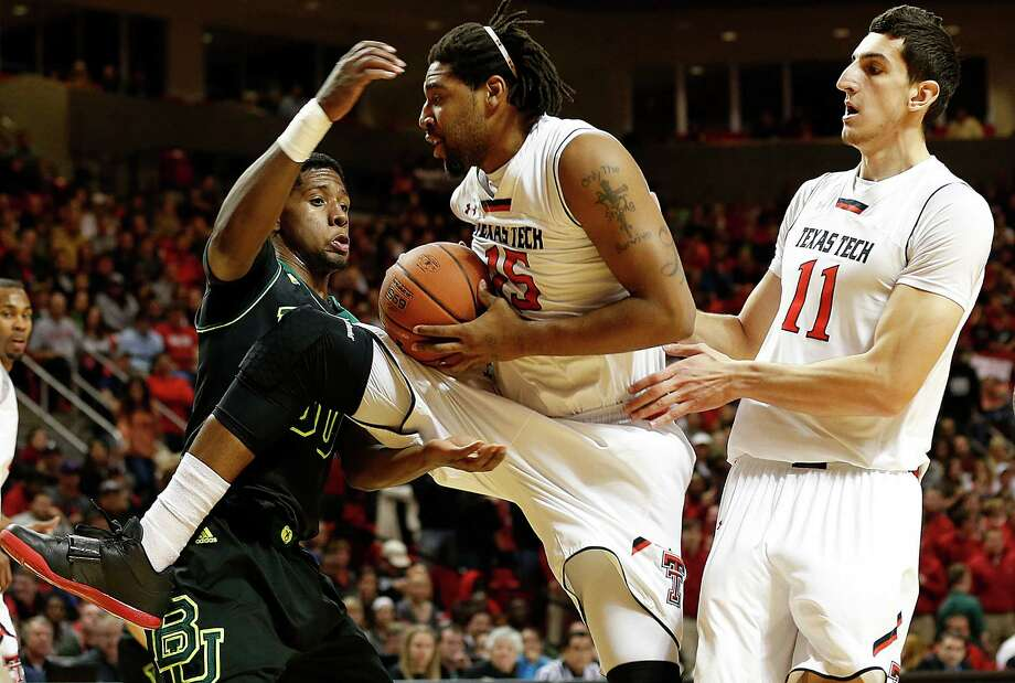 Texas Tech's Aaron Ross pulls a rebound away from Baylor's Royce O'Neale. Photo: Tori Eichberger, MBI / Lubbock Avalanche-Journal