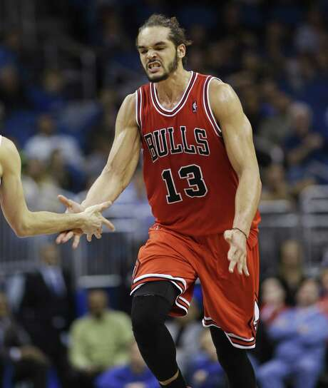 The Bulls' Joakim Noah scored a season-high 26 points in Chicago's 128-125 triple-overtime win at Orlando. The game featured 20 lead changes. Photo: John Raoux / Associated Press / AP