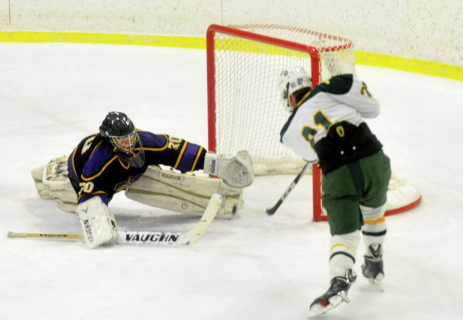 Westhill goalie Bradley Smith blocks the shot of Trinity Catholic's Eryk Wielgos during their hockey game at Terry Conners Rink in Stamford, Conn., on Wednesday, Jan. 15, 2014. Trinity Catholic won, 6-2. Photo: Jason Rearick / Stamford Advocate