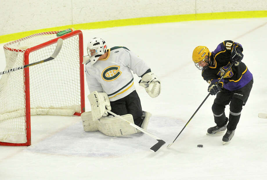 Westhill's Matthew Abt attempts to score on a rebound on Trinity Catholic goalie Kyle Odierno during their hockey game at Terry Conners Rink in Stamford, Conn., on Wednesday, Jan. 15, 2014. Trinity Catholic won, 6-2. Photo: Jason Rearick / Stamford Advocate