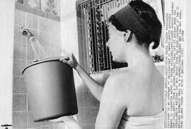 Feb. 2, 1977: Cindy Larios of San Rafael catches cold water from the shower during drought conditions in 1977.