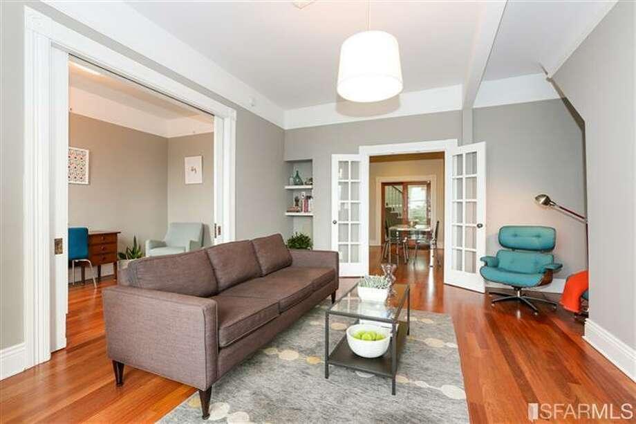 Living area, all total less than 740 square feet. Photos via Danielle Lazier, Climb Real Estate/MLS