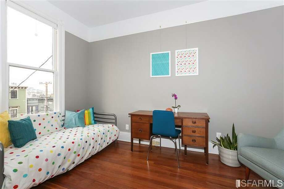 One of the 2 bedrooms. Photos via Danielle Lazier, Climb Real Estate/MLS