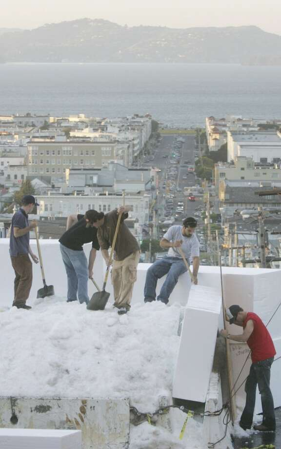 At the corner of Vallejo and Fillmore, local ski jump experts start construction on the snow ramp for Icer Air 2005 Photo: Mike Kepka, SFC