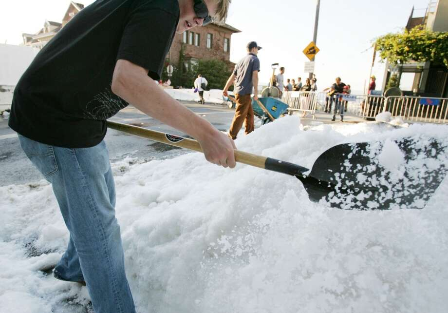 Parker Roe of San Francisco helps move snow at the corner of Vallejo and Fillmore Photo: Mike Kepka, SFC
