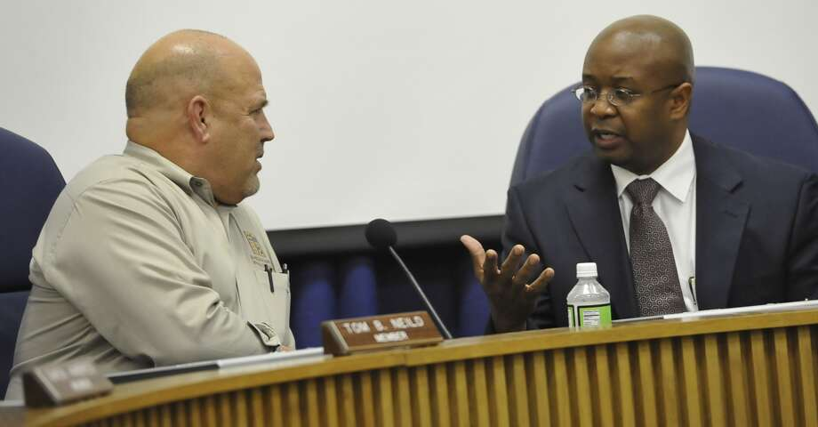 School Board member Tom Neild, left, listens to BISD Superintendent Timothy Chargois, right, before the start of the meeting in January 2013. Photo: Enterprise archives