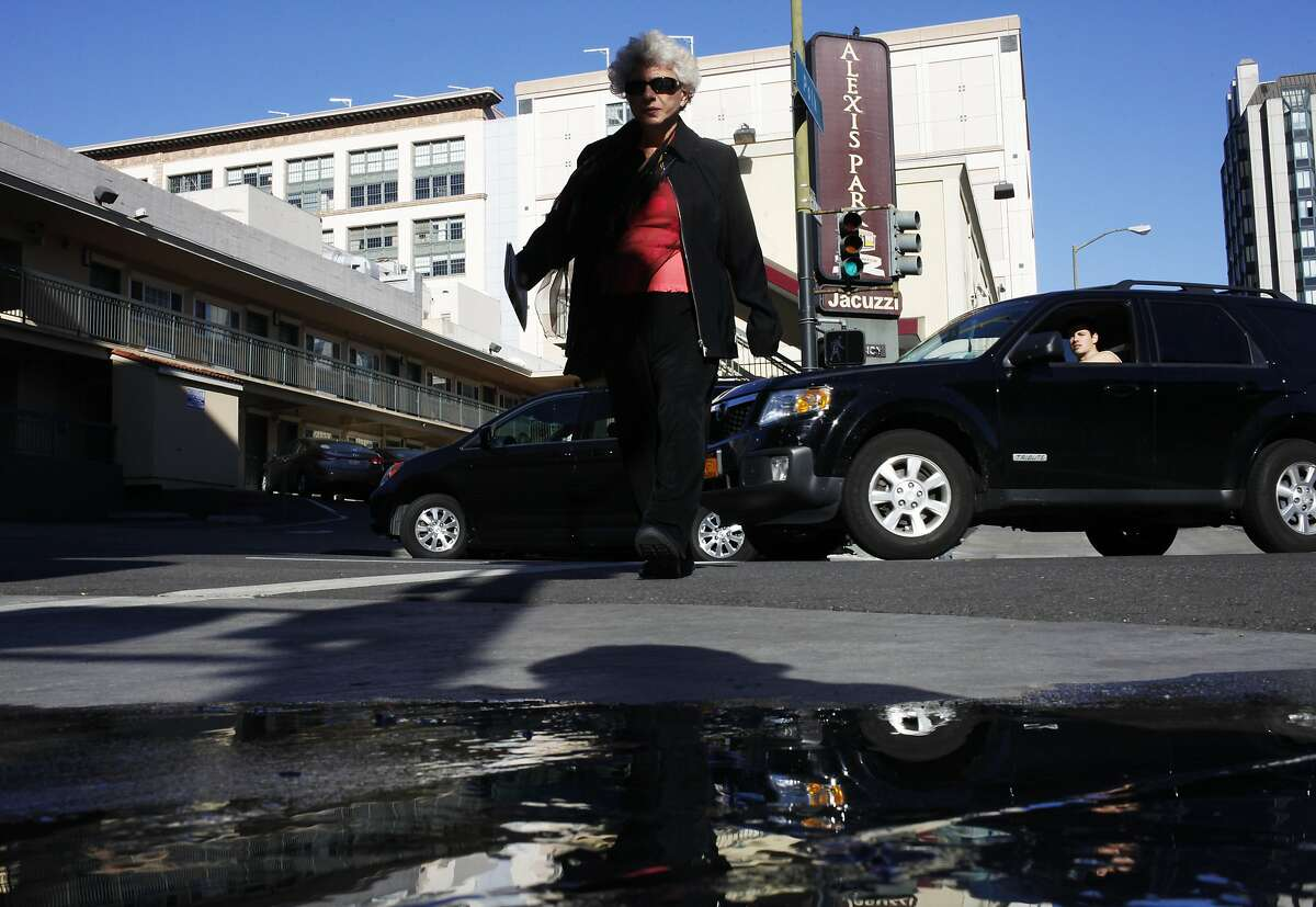 A pedestrian crosses Ellis Street as cars make the turn off of Polk Street, right, on January 15, 2014 in San Francisco, Calif. Sofia Liu, 6, was killed, and two people were injured at the intersection on New Year's Eve. Since New Year's Eve there has been a spate of pedestrian fatalities in San Francisco.