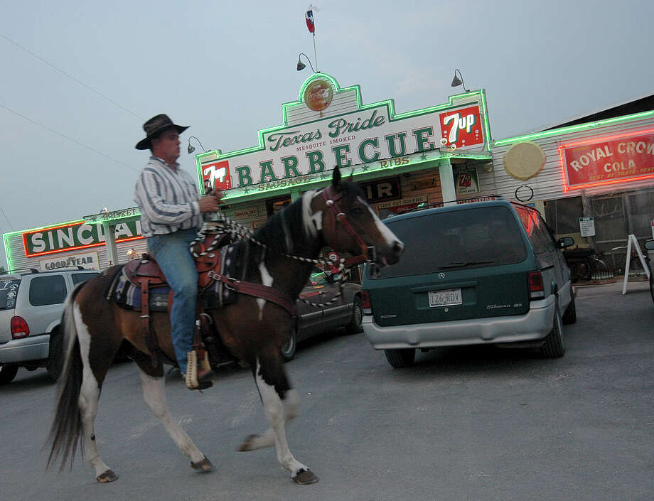 Good 'cue and a parking lot attendant on horseback at Texas Pride Barbecue in the small community of Adkins. It's hard to get more pure Texas than this. Texas Pride is located at 2980 E. Loop 1604, east of San Antonio; www.texaspridebbq.net. Photo: Karla Held, For The Express-News / SAN ANTONIO EXPRESS NEWS