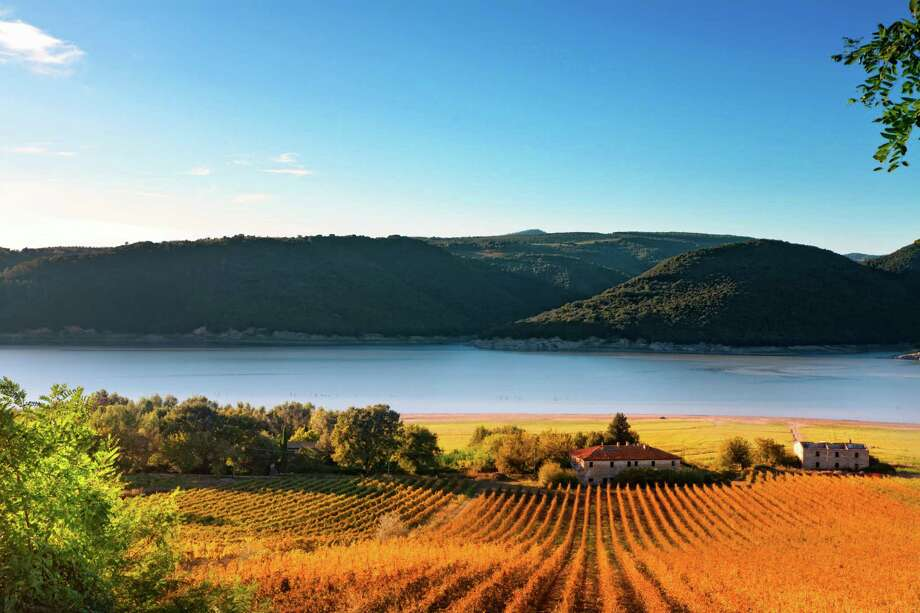"Corbara Lake in the Perugia district of Umbria is seen. ""Umbria's most celebrated wine is Sagrantino di Montefalco,"" says Wine Enthusiast. Photo: Francesco Iacobelli, Getty Images / AWL Images RM"
