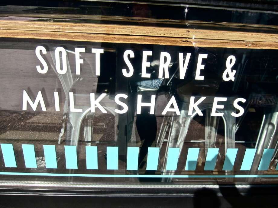 Window graphics at Fat Cat Creamery in the Heights. Photo: Alison Cook