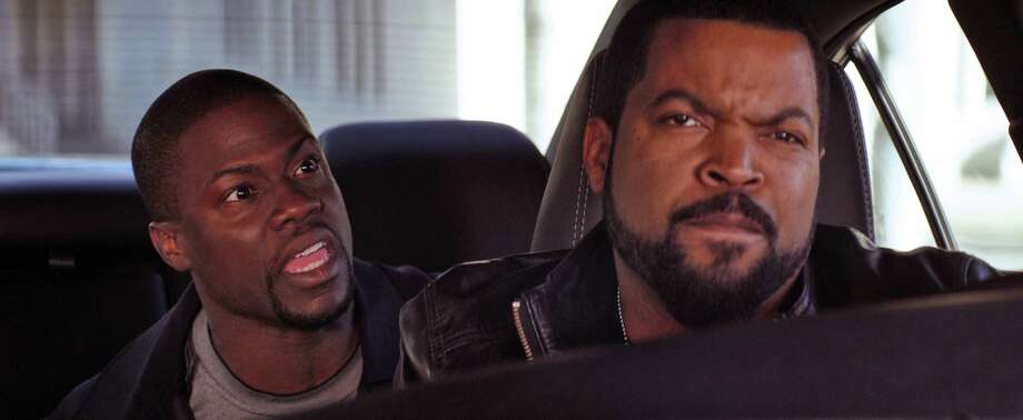 "Kevin Hart, left, and Ice Cube star in ""Ride Along."" Photo: HOEP / Universal Pictures"