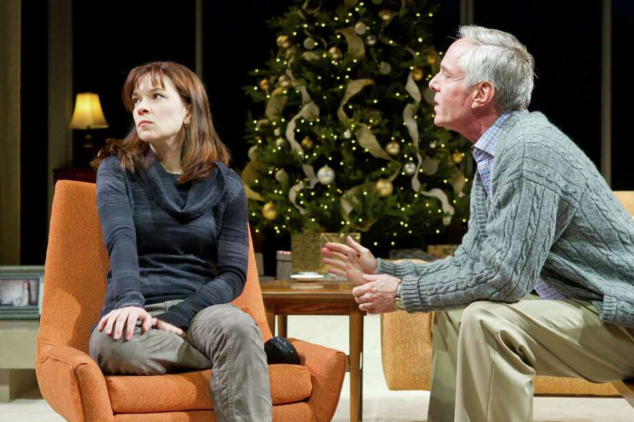 "Lyman (Richard Bekins) attempts to persuade Brooke (Elizabeth Bunch) to not publish a book that explores the suicide of her older brother and the role the family played, in ""Other Desert Cities."" Photo: Brett Coomer, Staff / © 2014 Houston Chronicle"