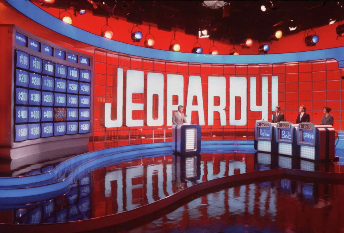 What is 'Jeopardy!' The answer-and-question game show began as a daytime broadcast on NBC, hosted by Art Fleming. It survived from 1964 to Jan. 3, 1975. It was revived for weekly syndication from September 1974 to September 1975 and on NBC from October 1978 to March 1979. The current incarnation, hosted by Alex Trebek, made its debut in syndication on Sept. 10, 1984.