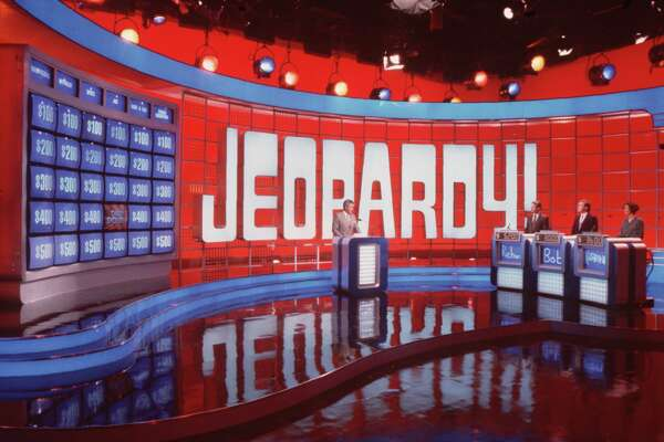 "television game show JEOPARDY 1991- Alex Trebek. HOUCHRON CAPTION (04/02/1999): CBS' purchase of King World Productions will bring to the network the distributor of such TV shows as ""Jeopardy!,"" left; ""Wheel of Fortune,"" with Vanna White and Pat Sajak; and ""The Oprah Winfrey Show."" HOUCHRON CAPTION (03/28/2004): A weeklong ""Jeopardy!"" in May will feature media types and political figures."