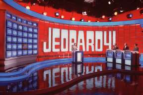 """television game show JEOPARDY 1991- Alex Trebek. HOUCHRON CAPTION (04/02/1999): CBS' purchase of King World Productions will bring to the network the distributor of such TV shows as """"Jeopardy!,"""" left; """"Wheel of Fortune,"""" with Vanna White and Pat Sajak; and """"The Oprah Winfrey Show."""" HOUCHRON CAPTION (03/28/2004): A weeklong """"Jeopardy!"""" in May will feature media types and political figures."""