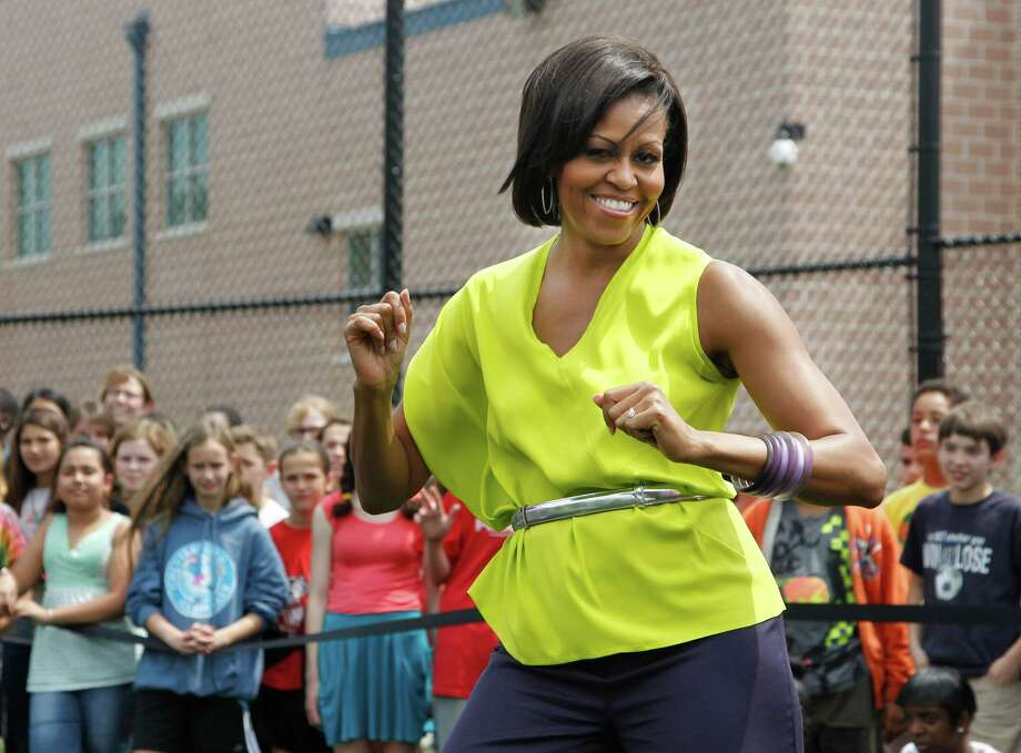 First lady Michelle Obama dances with students at Alice Deal Middle School in northwest Washington, during a surprise visit for the school's Let's Move! event. She turns 50 on Jan. 17. What else happened 50 years ago? Keep clicking to find out. Photo: Manuel Balce Ceneta, STF / AP