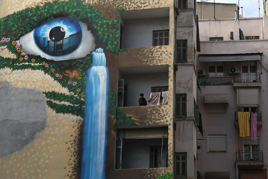 Neighborhood watch: A giant eyeball decorates an apartment building in the northern Greek port city of Thessaloniki. Photo: Nikolas Giakoumidis, Associated Press