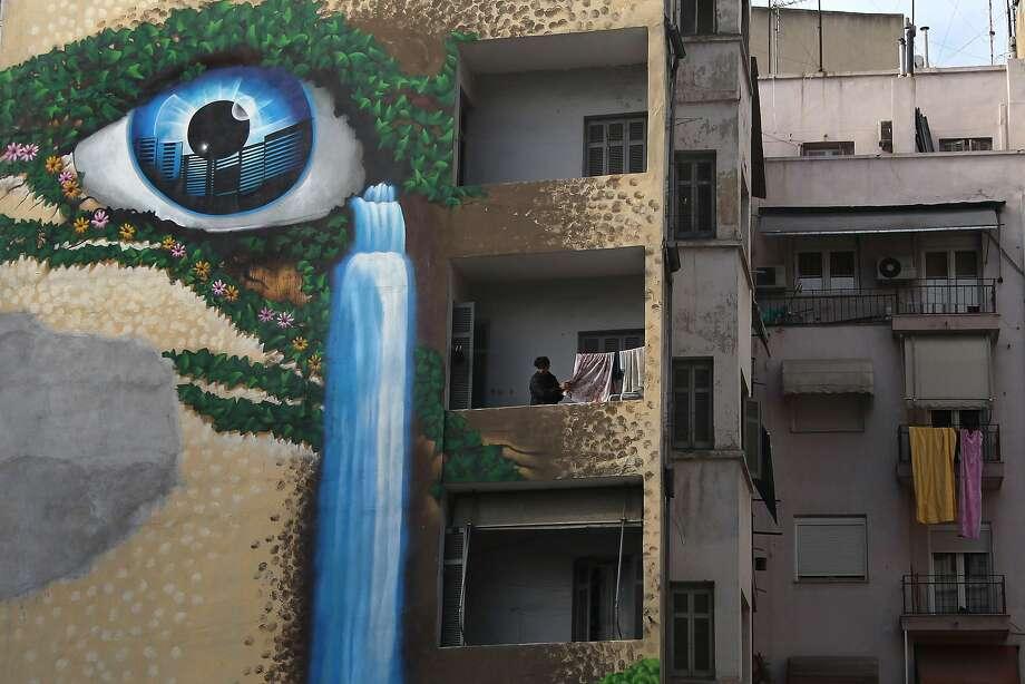 Neighborhood watch:A giant eyeball decorates an apartment building in the northern Greek port city of Thessaloniki. Photo: Nikolas Giakoumidis, Associated Press