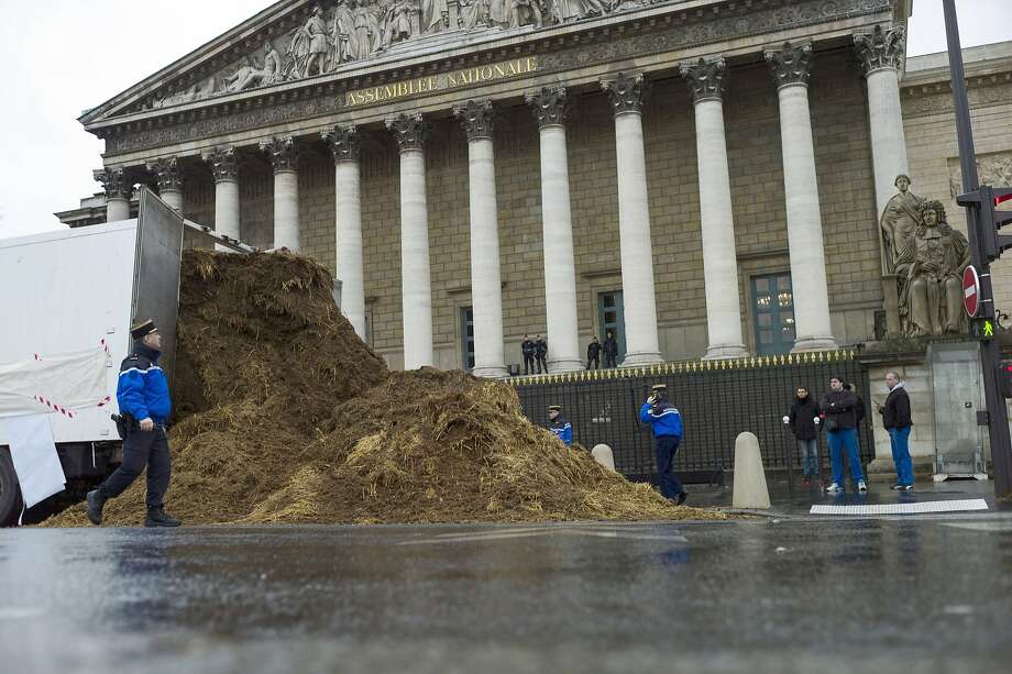 Somebody want to sign for this?An unidentified trucker makes a delivery of fresh manure at the French National   Assembly in Paris. Gendarmes soon took him into custody. Photo: Fred Dufour, AFP/Getty Images